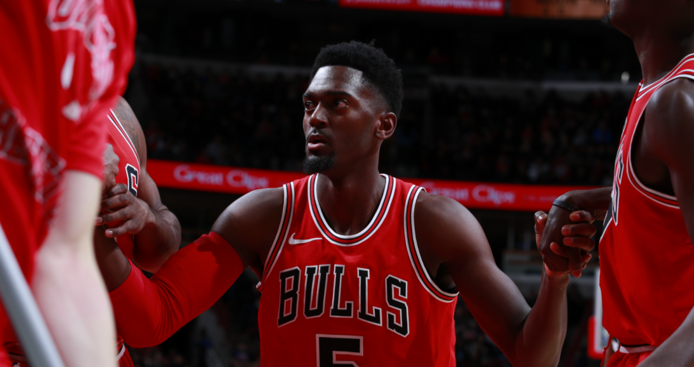 Bobby Portis gets a hand from his teammates during the Bulls' last matchup against the Raptors