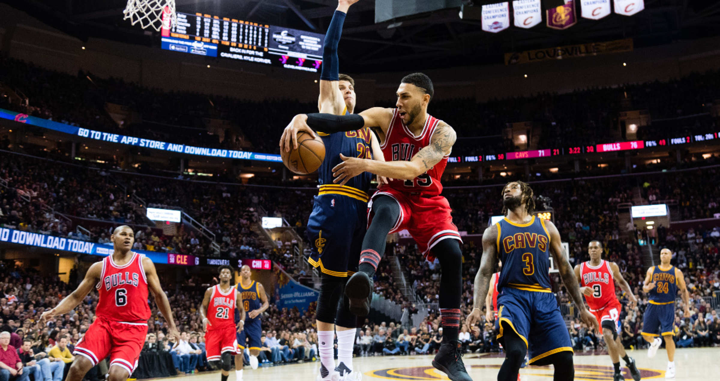 Denzel Valentine #45 of the Chicago Bulls passes around Kyle Korver #26 of the Cleveland Cavaliers during the second half at Quicken Loans Arena on February 25, 2017 in Cleveland, Ohio. The Bulls defeated the Cavaliers 117-99.
