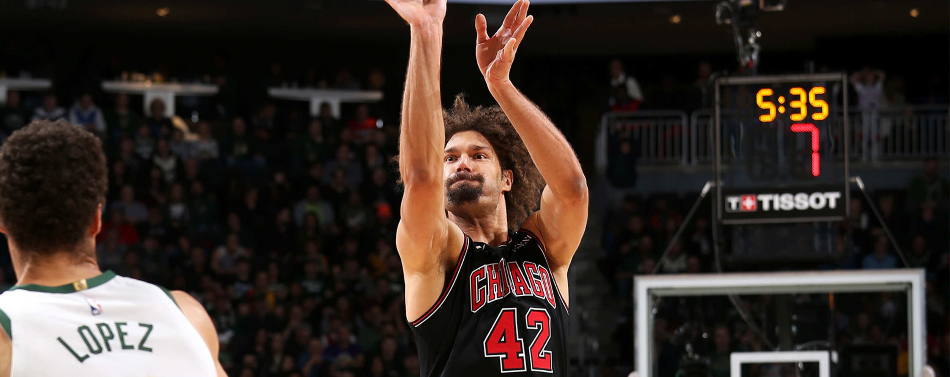 Robin Lopez from the Chicago Bulls shoots over Brook Lopez from the Milwaukee Bucks
