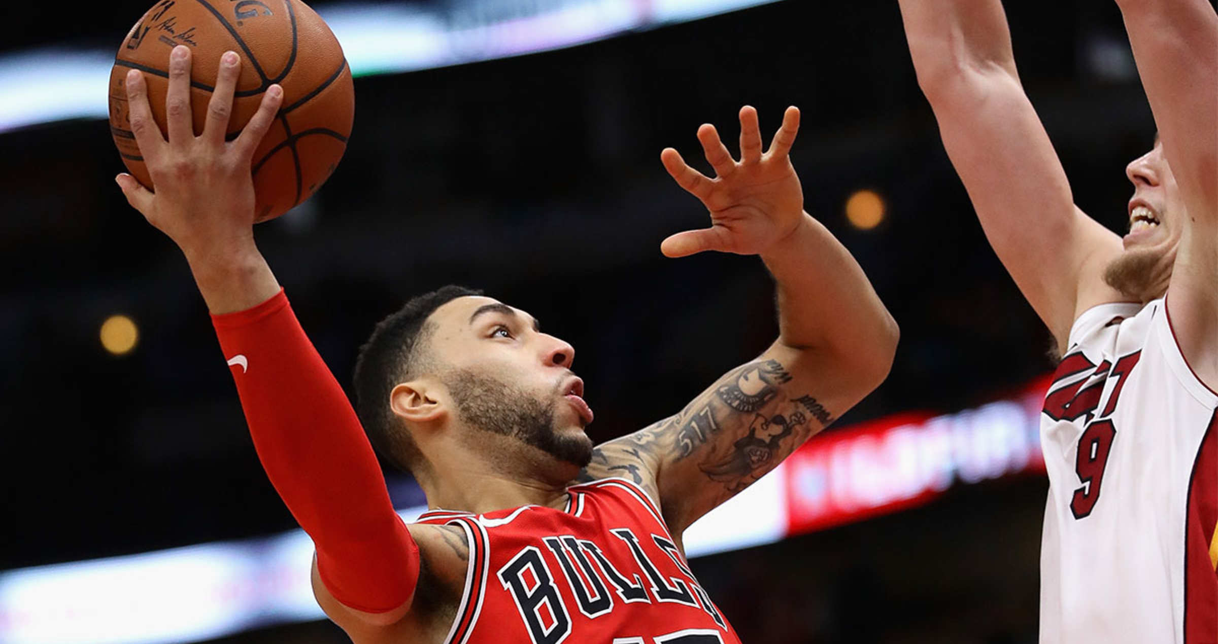 Denzel Valentine #45 of the Chicago Bulls shoots against Kelly Olynyk #9 of the Miami Heat at the United Center