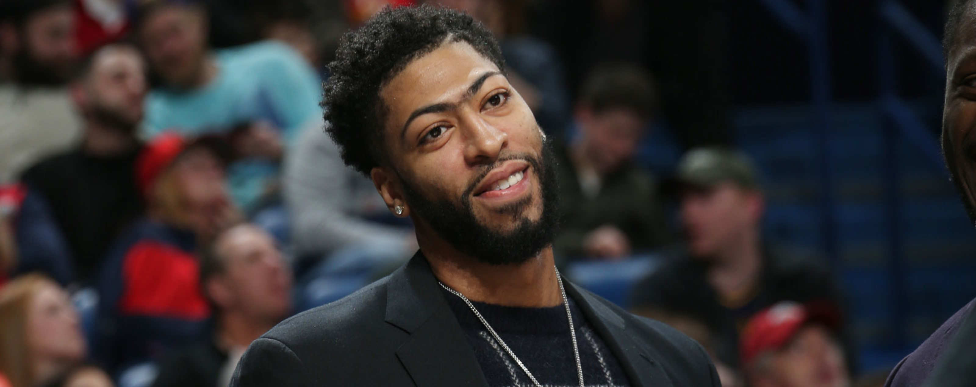 Anthony Davis number 23 of the New Orleans Pelicans smiles against the Denver Nuggets on January 30, 2019 at the Smoothie King Center in New Orleans, Louisiana