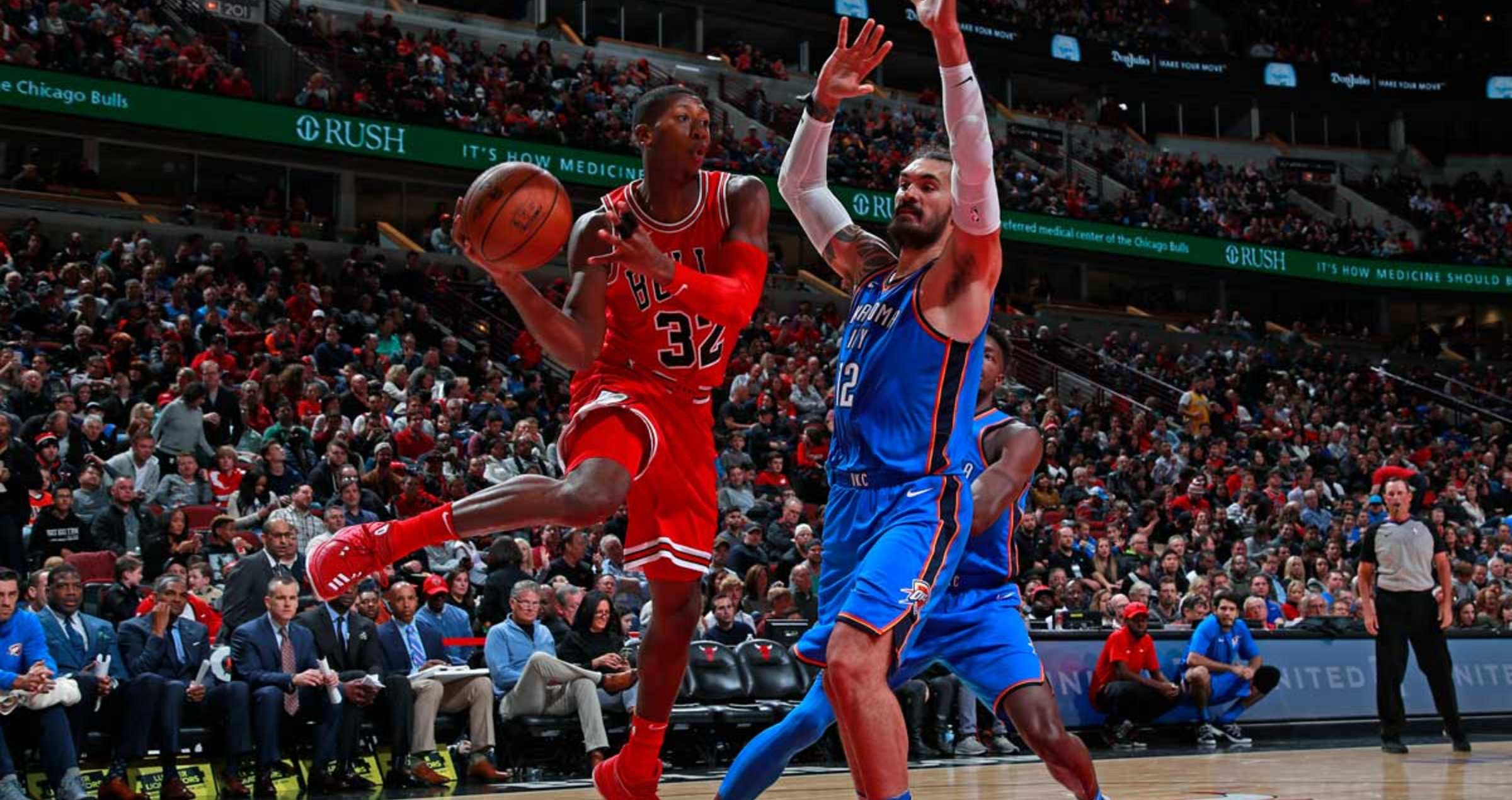 Kris Dunn #32 of the Chicago Bulls passes the ball against the Oklahoma City Thunder on October 28, 2017 at the United Center in Chicago, Illinois.