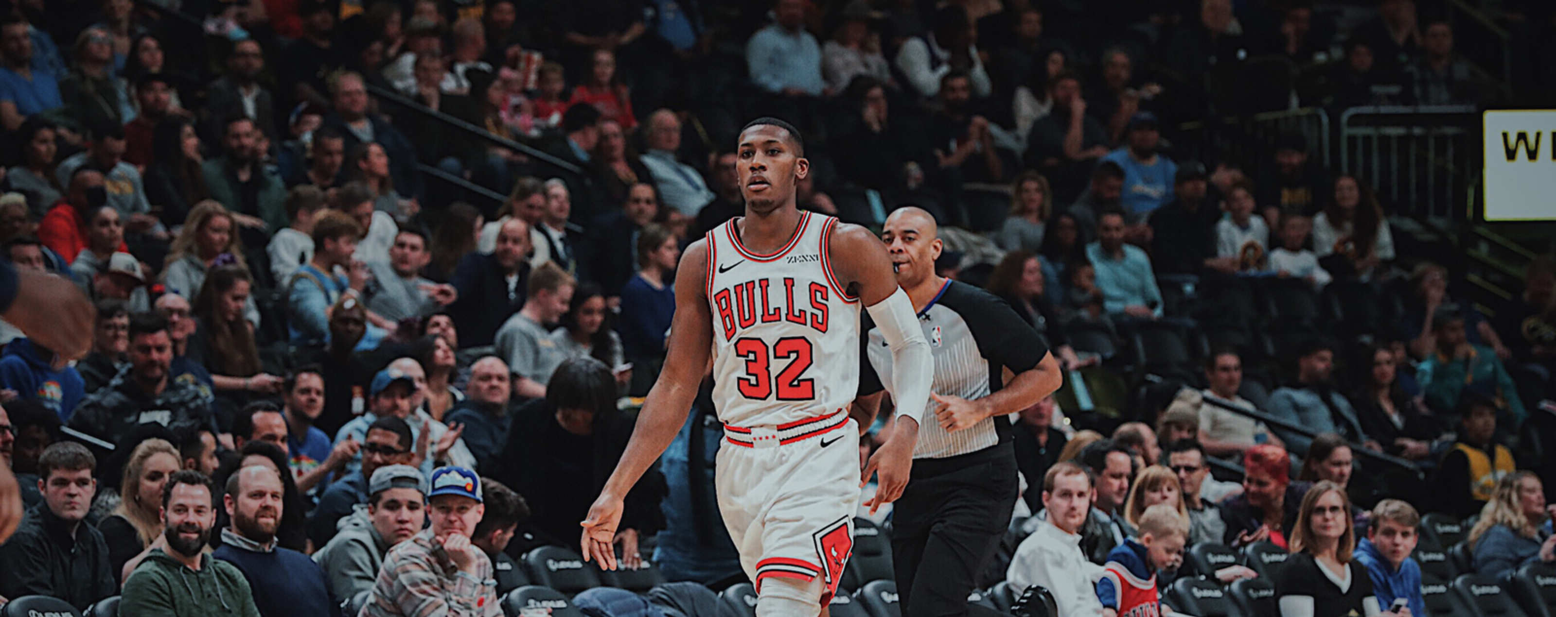 Kris Dunn dribbles the ball against the Denver Nuggets.