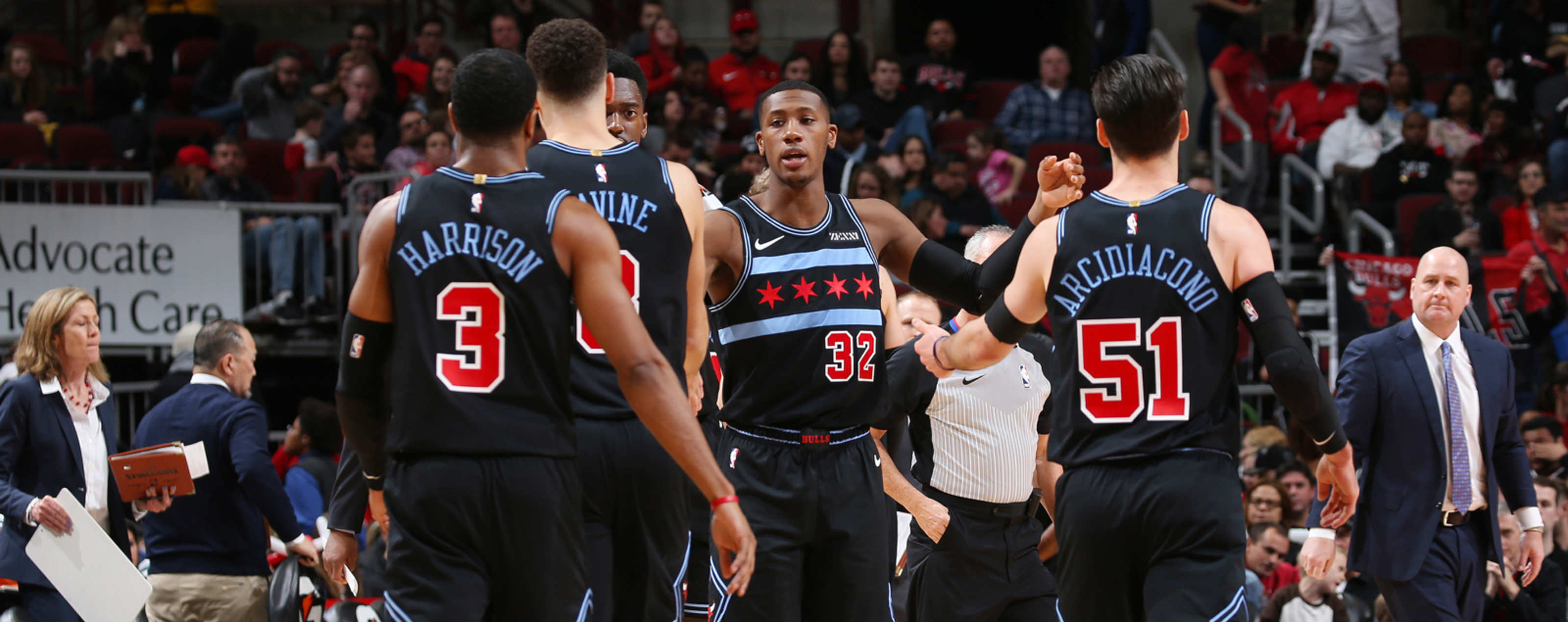 Kris Dunn #32 of the Chicago Bulls celebrates with his team during the game against the Brooklyn Nets on January 6, 2019 at the United Center in Chicago, Illinois.