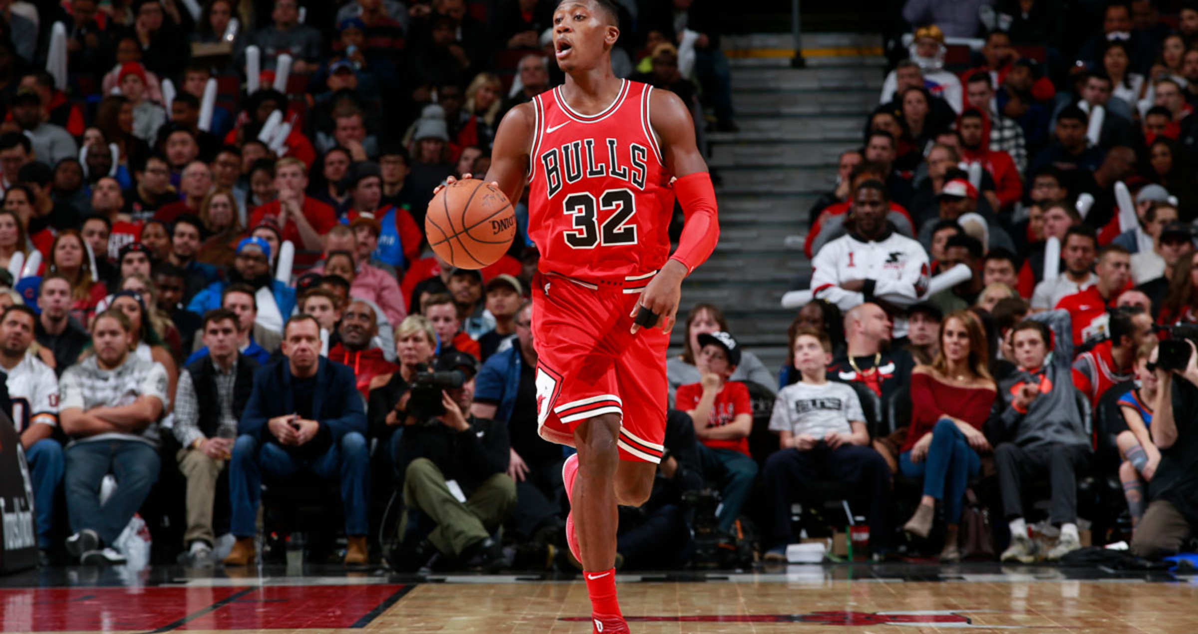 Kris Dunn #32 of the Chicago Bulls handles the ball against the Oklahoma City Thunder on October 28, 2017 at the United Center in Chicago, Illinois.