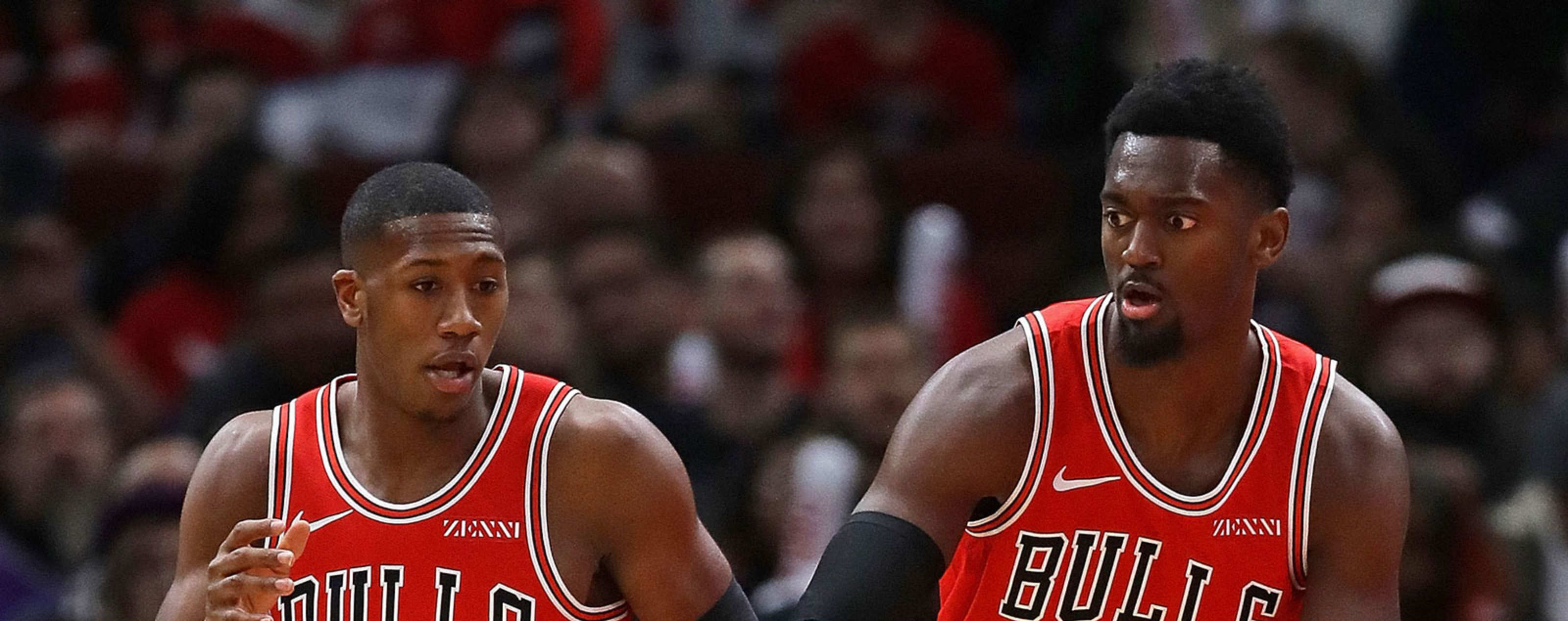 Kris Dunn #32 and Bobby Portis #5 of the Chicago Bulls return to the game against the Sacramento Kings after being injured at the United Center on December 10, 2018 in Chicago, Illinois.