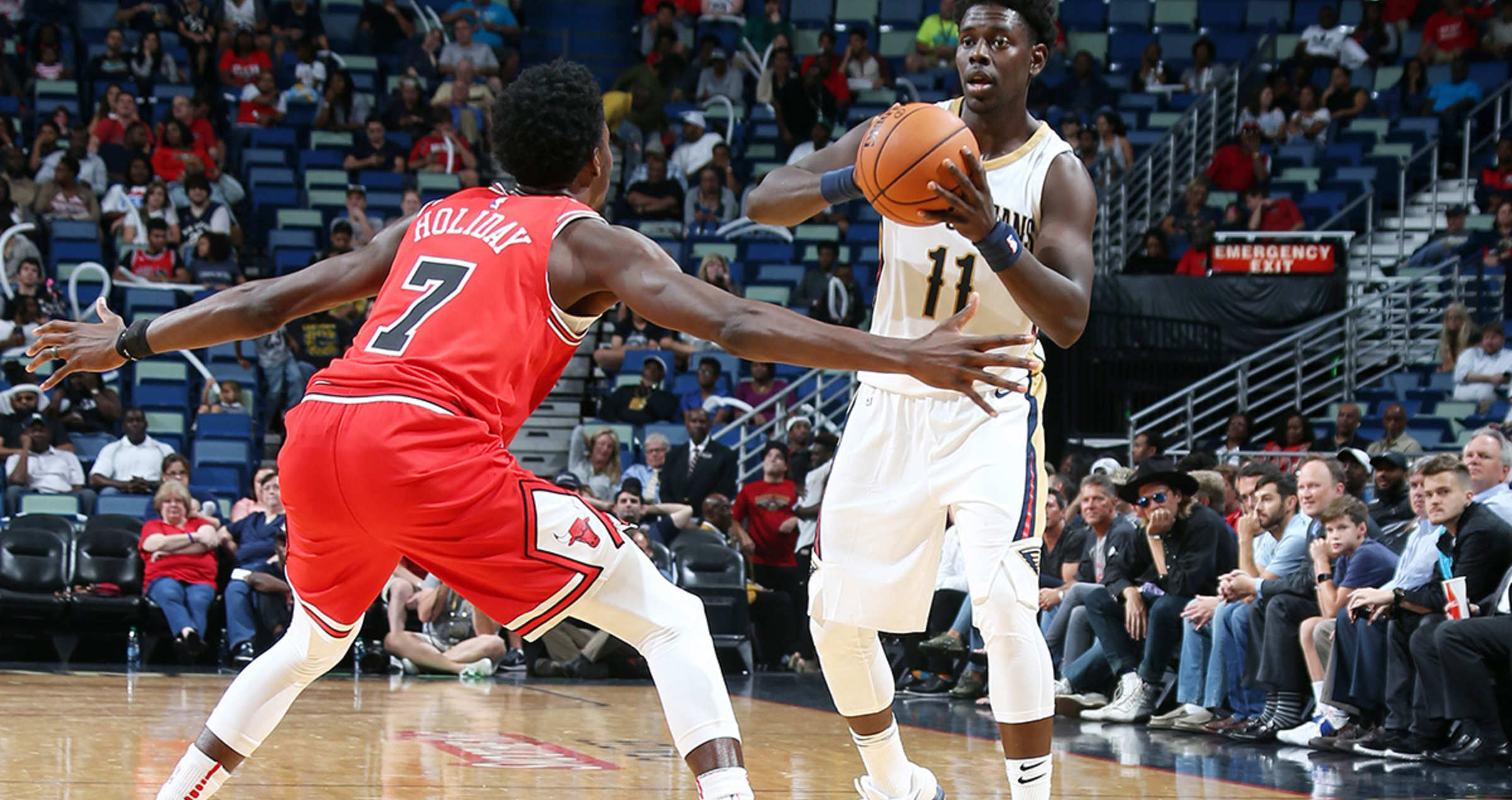 Jrue Holiday #11 of the New Orleans Pelicans handles the ball during a preseason game against the Chicago Bulls on October 3, 2017 at the Smoothie King Center in New Orleans, Louisiana.