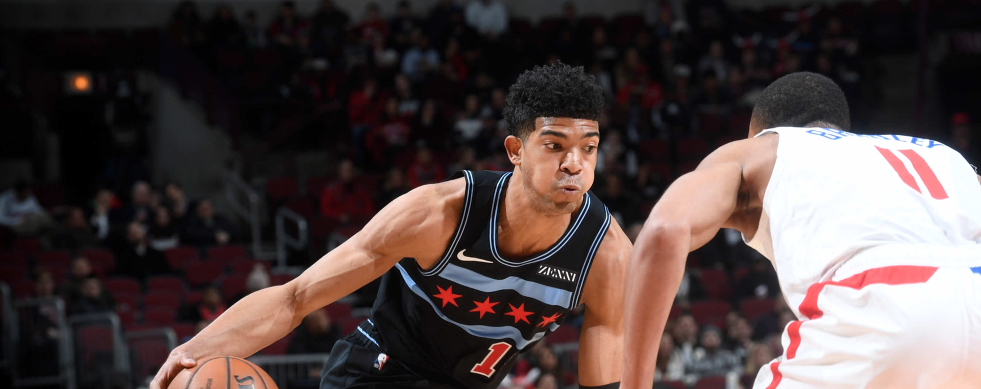 Chandler Hutchison drives to the rim against the Los Angeles Clippers.