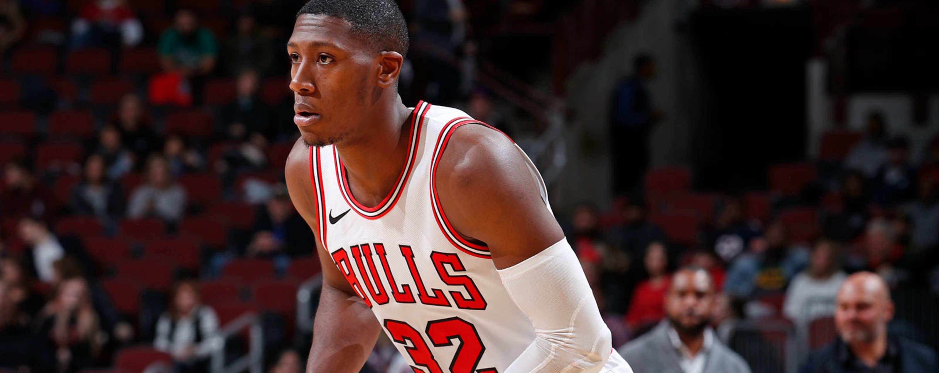 Kris Dunn #32 of the Chicago Bulls dribbles the ball against the Denver Nuggets during a pre-season game on October 12, 2018 at the United Center in Chicago, Illinois.