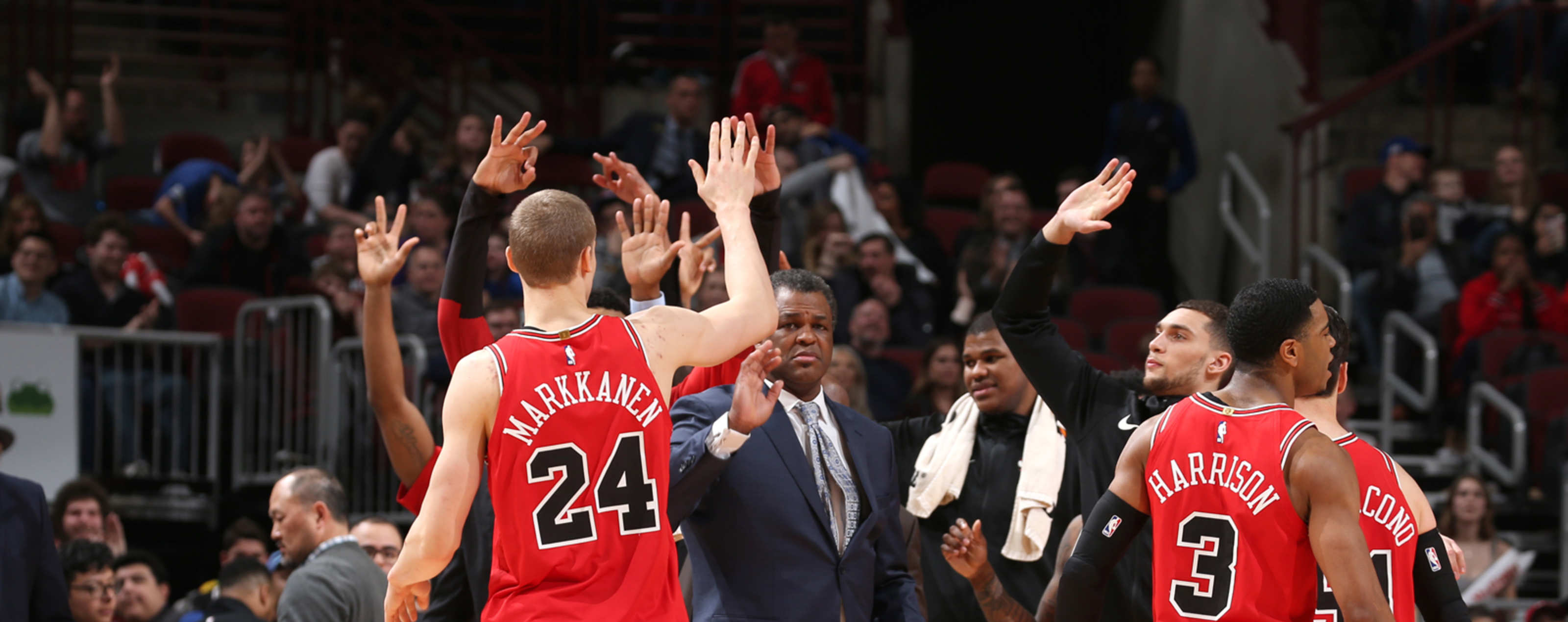 Lauri Markkanen #24 of the Chicago Bulls high fives his teammates during the game against the Washington Wizards on March 20, 2019 at the United Center in Chicago, Illinois.