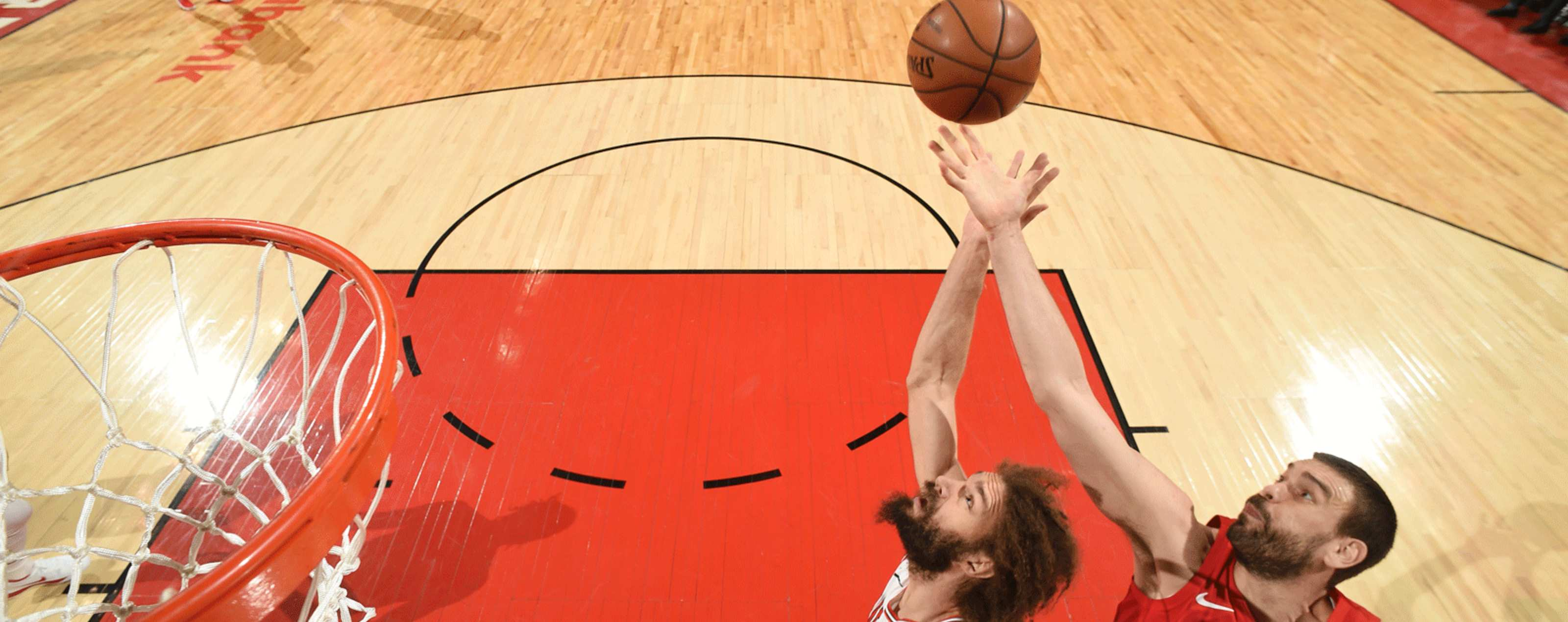 Robin Lopez #42 of the Chicago Bulls and Marc Gasol #33 of the Toronto Raptors go up for the rebound on March 26, 2019 at the Scotiabank Arena in Toronto, Ontario, Canada.