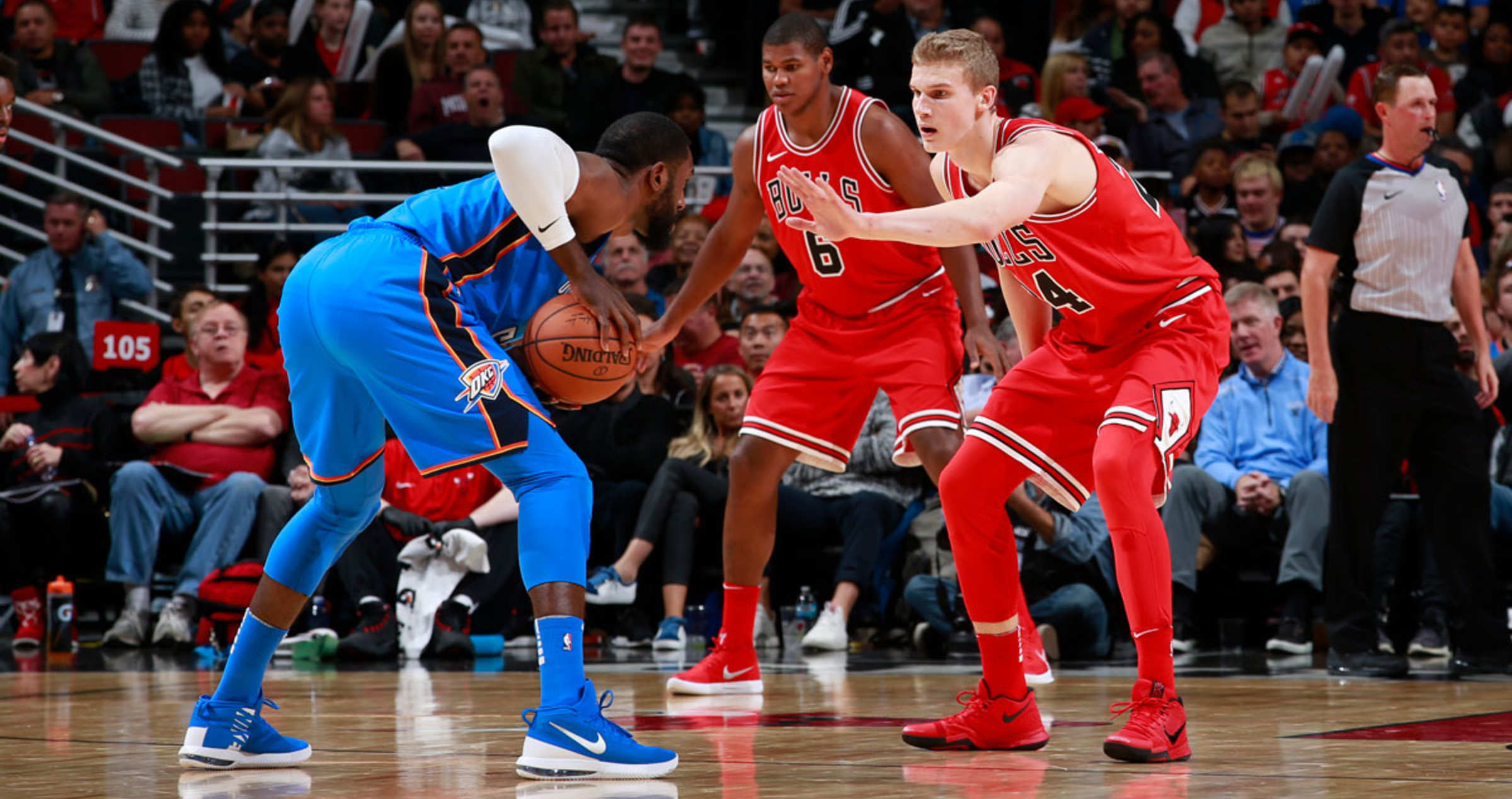 Lauri Markkanen #24 of the Chicago Bulls defends against the Oklahoma City Thunder on October 28, 2017 at the United Center in Chicago, Illinois.