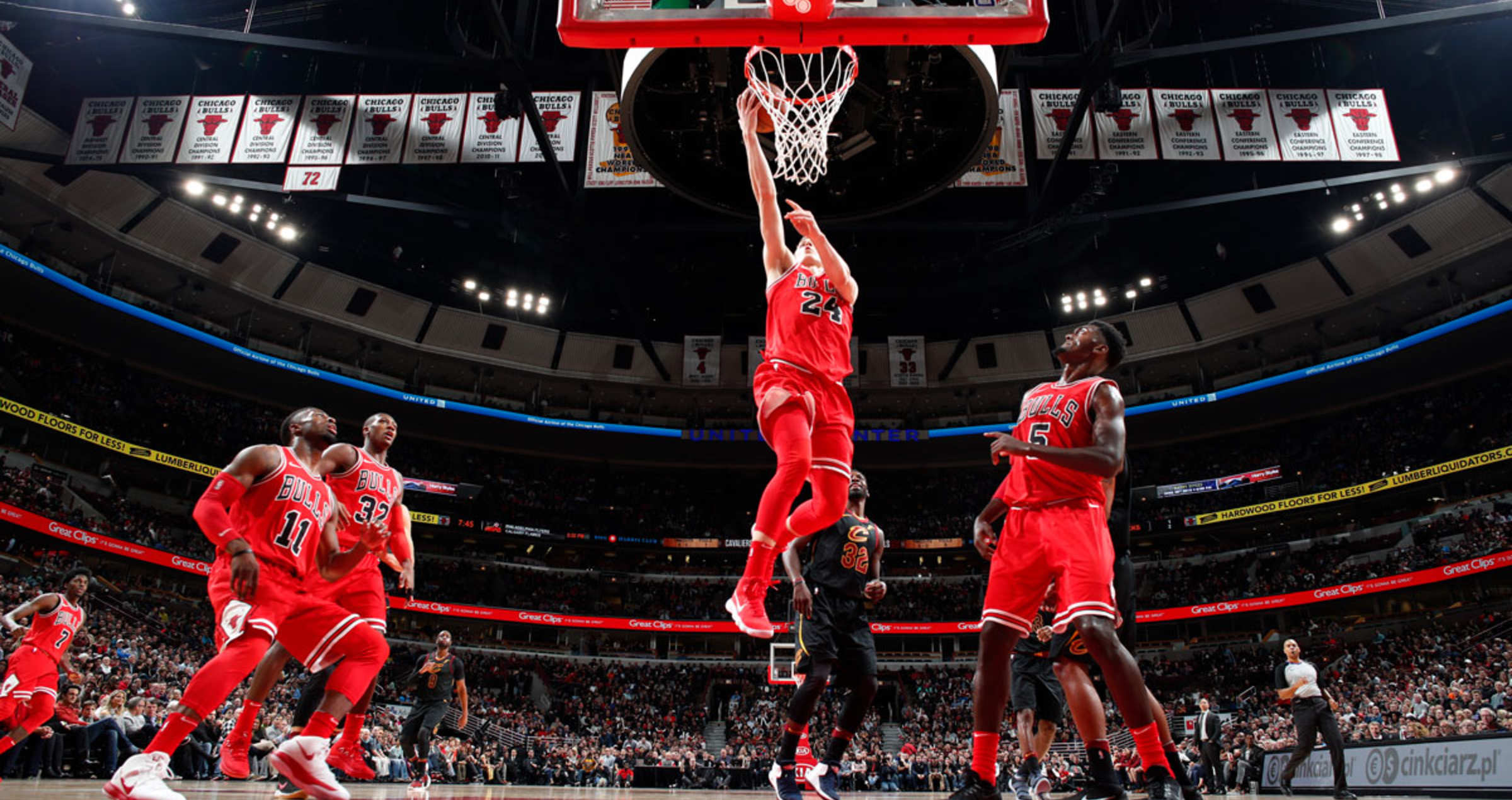 Lauri Markkanen #24 of the Chicago Bulls dunks against the Cleveland Cavaliers on December 4, 2017 at the United Center in Chicago, Illinois.