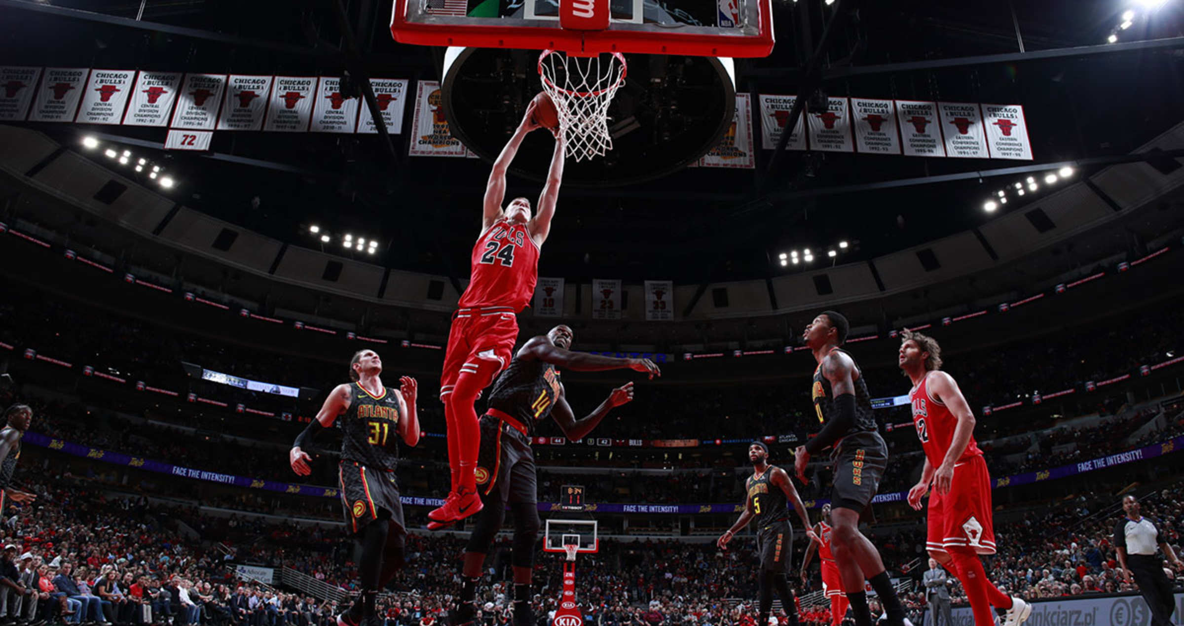 Lauri Markkanen #24 of the Chicago Bulls scores against the Atlanta Hawks on October 26, 2017 at the United Center, Chicago, Illinois.