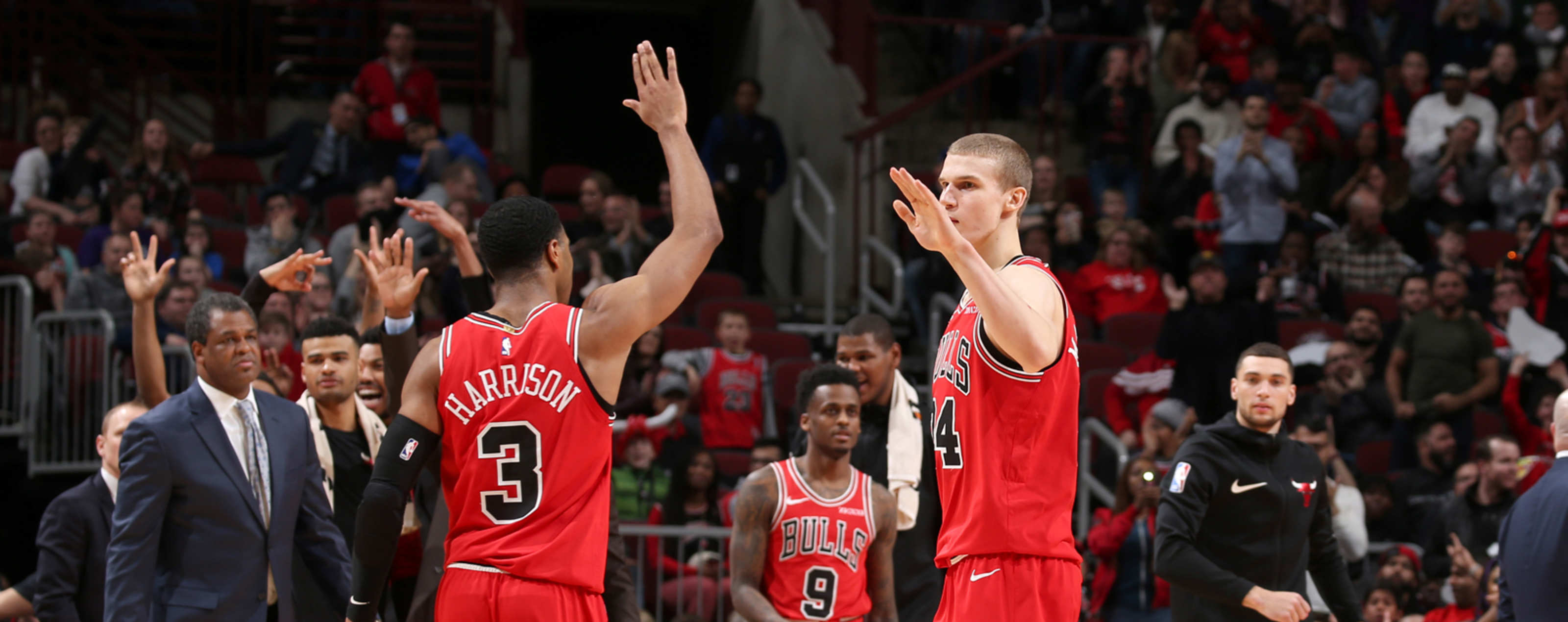 Shaquille Harrison #3 and Lauri Markkanen #24 of the Chicago Bulls high five during the game against the Washington Wizards on March 20, 2019 at the United Center in Chicago, Illinois