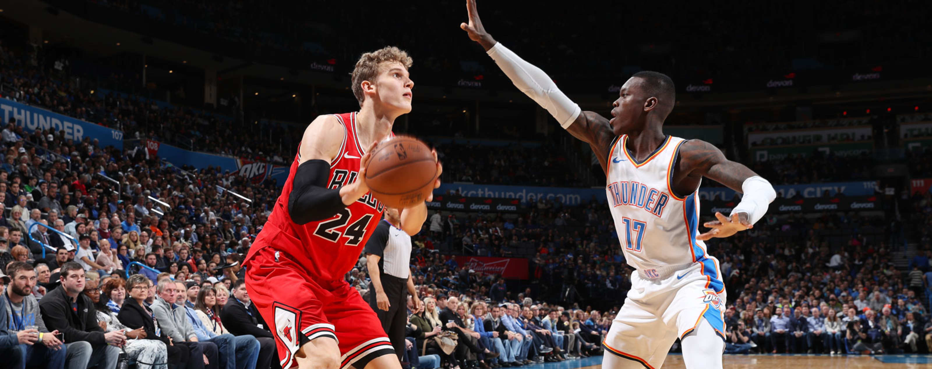 Lauri Markkanen #24 of the Chicago Bulls shoots the ball during the game against Dennis Schroder #17 of the Oklahoma City Thunder on December 17, 2018 at Chesapeake Energy Arena in Oklahoma City, Oklahoma.