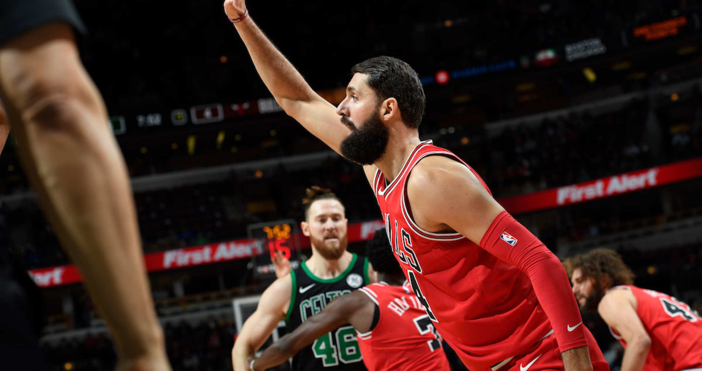 Nikola Mirotic signaling to his teammates during a game against the Boston Celtics.