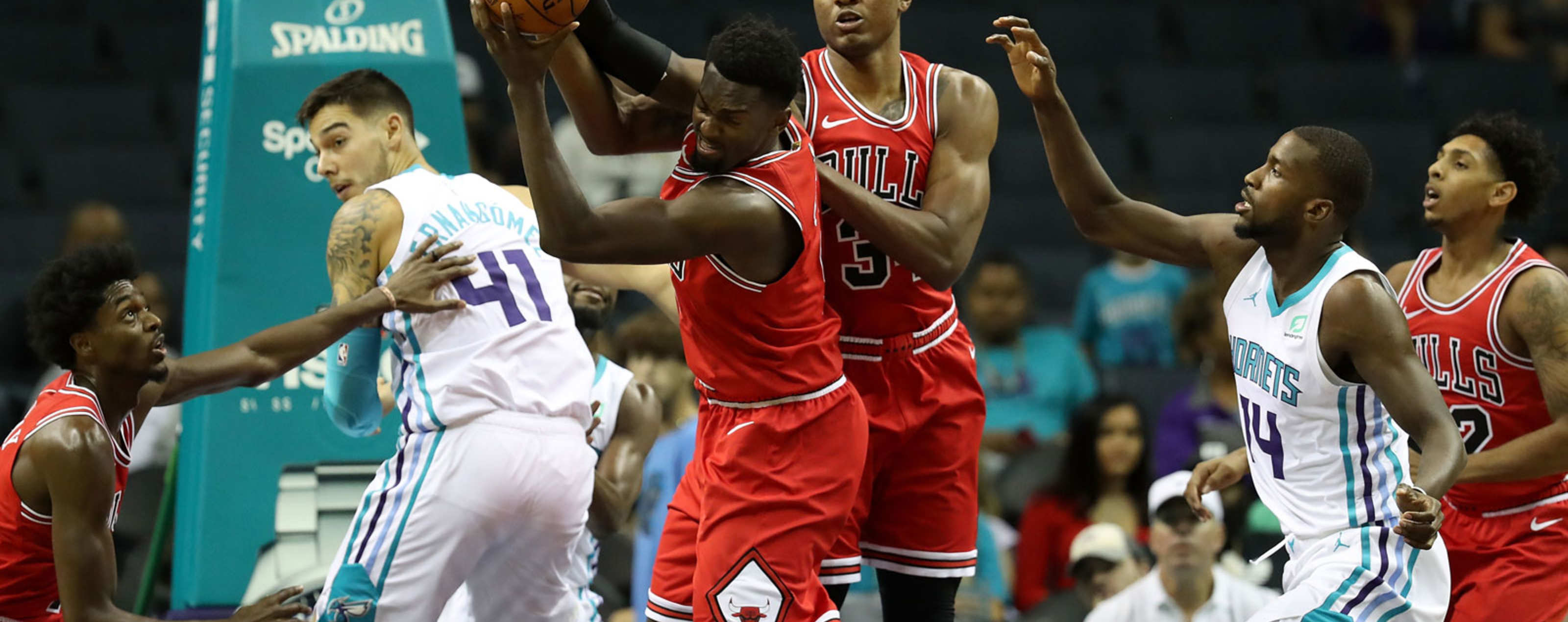 : Bobby Portis #5 of the Chicago Bulls grabs the ball against the Charlotte Hornets during their game at Spectrum Center on October 8, 2018 in Charlotte, North Carolina.