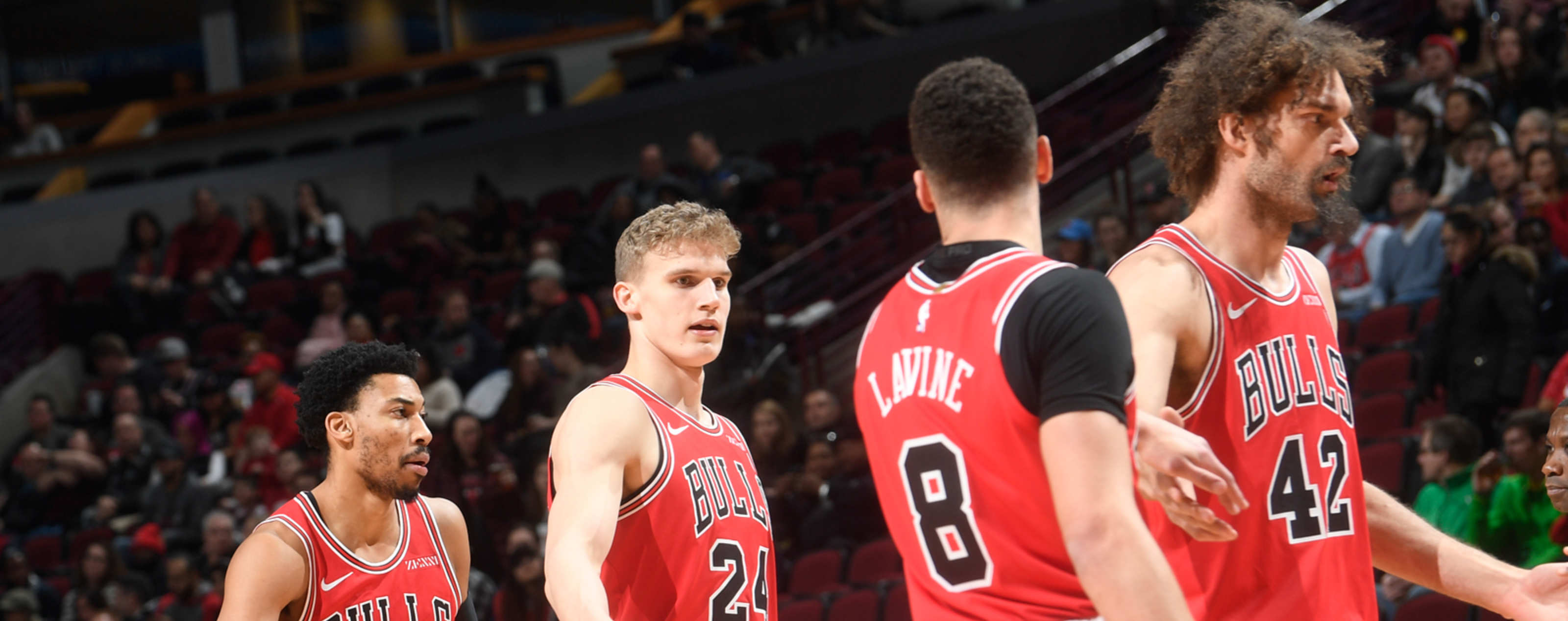 Chicago Bulls players walk to the bench during a timeout.