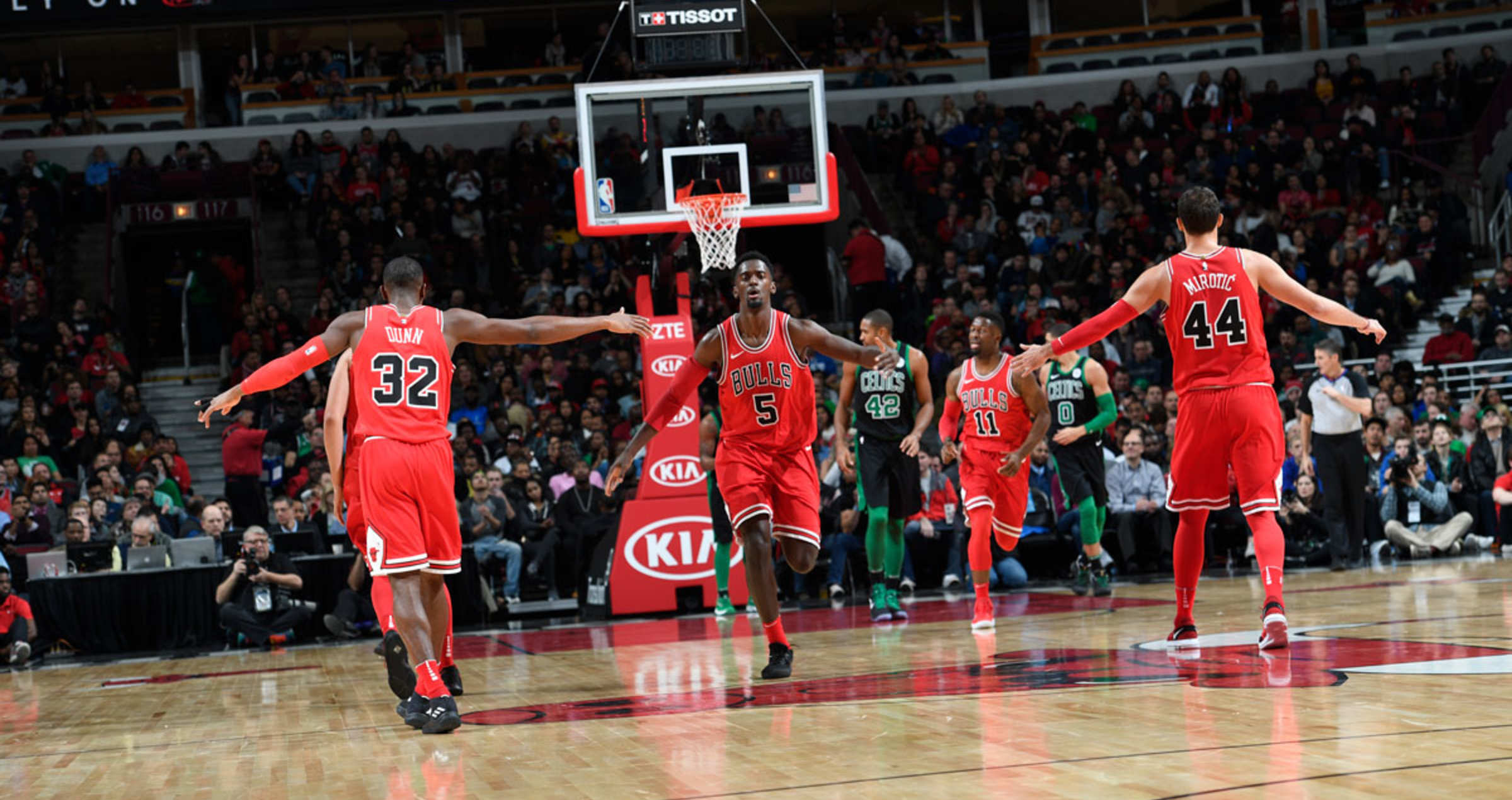 The Bulls giving each other props after a bucket against the Boston Celtics, December 11, 2017 at the United Center, Chicago, Illinois.