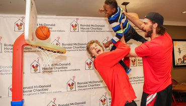 Robin Lopez and Lauri Markkanen celebrate St. Patrick's Day at Ronald McDonald House