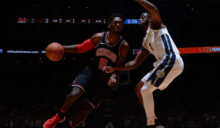 Bobby Portis #5 of the Chicago Bulls handles the ball against the Denver Nuggets on November 30, 2017 at the Pepsi Center in Denver, Colorado.