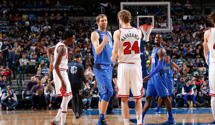 Dirk Nowitzki #41 of the Dallas Mavericks and Lauri Markkanen #24 of the Chicago Bulls shake hands before the game on January 5, 2018 at the American Airlines Center in Dallas, Texas.