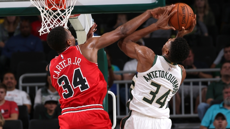 Wendell Carter Jr. #34 of the Chicago Bulls blocks a shot against Giannis Antetokounmpo #34 of the Milwaukee Bucks during a pre-season game on October 3, 2018 at Fiserv Forum, in Milwaukee, Wisconsin.