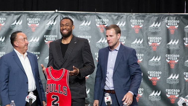 Jabari Parker poses with his jersey with Gar Forman and Fred Hoiberg