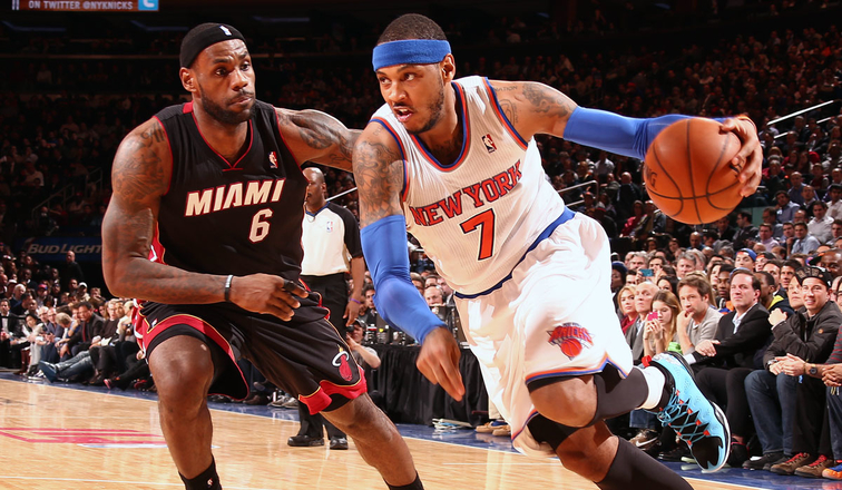 Carmelo Anthony drives against LeBron James