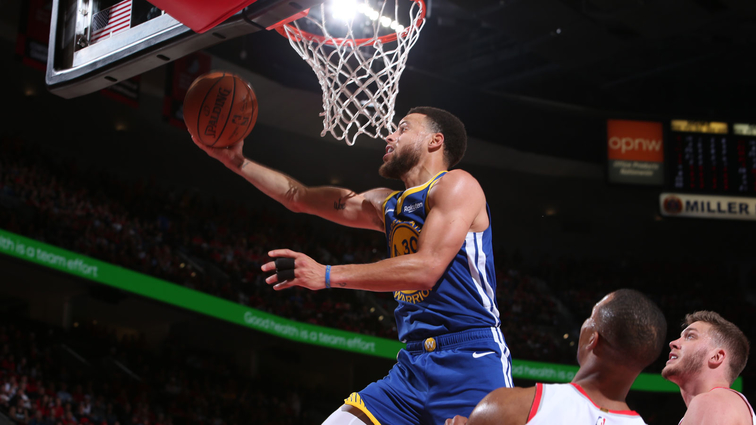Stephen Curry #30 of the Golden State Warriors goes to the basket against the Portland Trail Blazers during Game Four of the Western Conference Finals on May 20, 2019 at the Moda Center in Portland, Oregon.