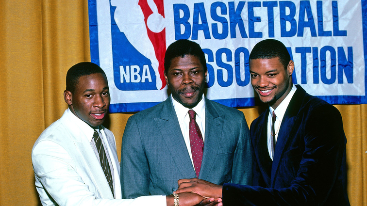 Draft prospects Ed Pinckney, Benoit Benjamin and Patrick Ewing pose for a photo during the NBA Draft on June 18, 1985 at Felt Forum in New York City.