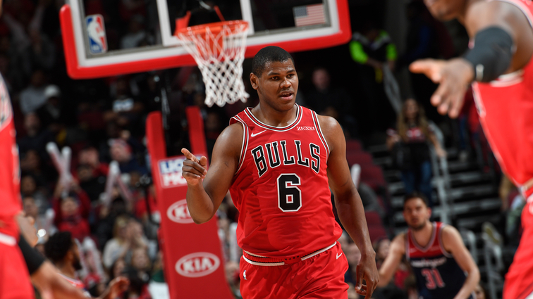 Cristiano Felicio celebrates after making a play against the Washington Wizards