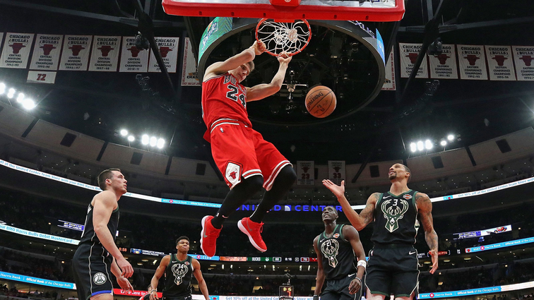 Lauri Markkanen dunks the ball against the Milwaukee Bucks.