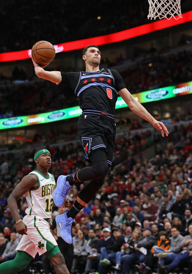 Zach LaVine dunks against the Boston Celtics.