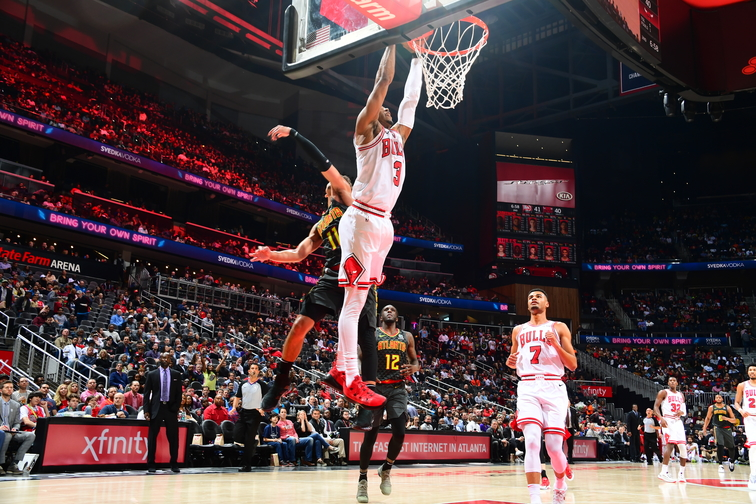 Shaquille Harrison dunks against the Atlanta Hawks.