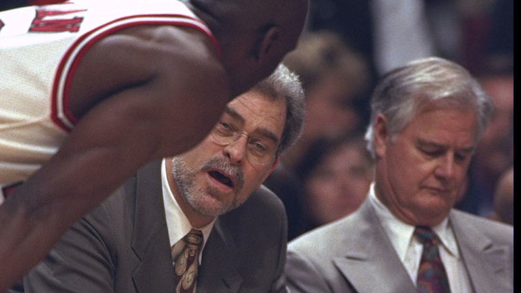 Head coach Phil Jackson of the Chicago Bulls talks with Michael Jordan and Tex Winter during the first round of the NBA Playoffs against the Washington Bullets at United Center in Chicago, Illinois.