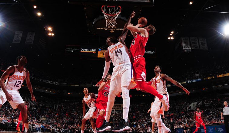 #24 Lauri Markkanen of the Chicago Bulls shoots the ball against #14 Greg Monroe of the Phoneix Suns on November 19, 2017 at the Talking Stick Resort Arena, Phoenix, AZ