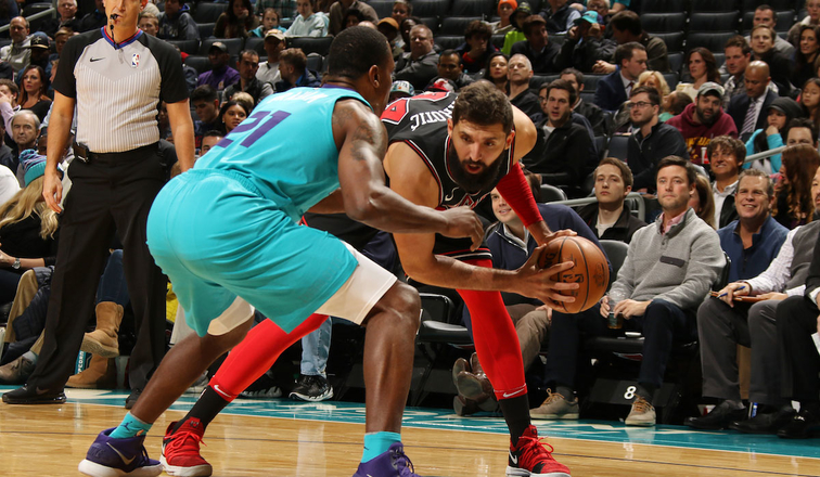 Nikola Mirotic #44 of the Chicago Bulls handles the ball against the Charlotte Hornets on December 8, 2017 at Spectrum Center in Charlotte, North Carolina.