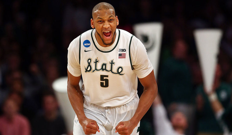 Adreian Payne on the floor with Michigan State
