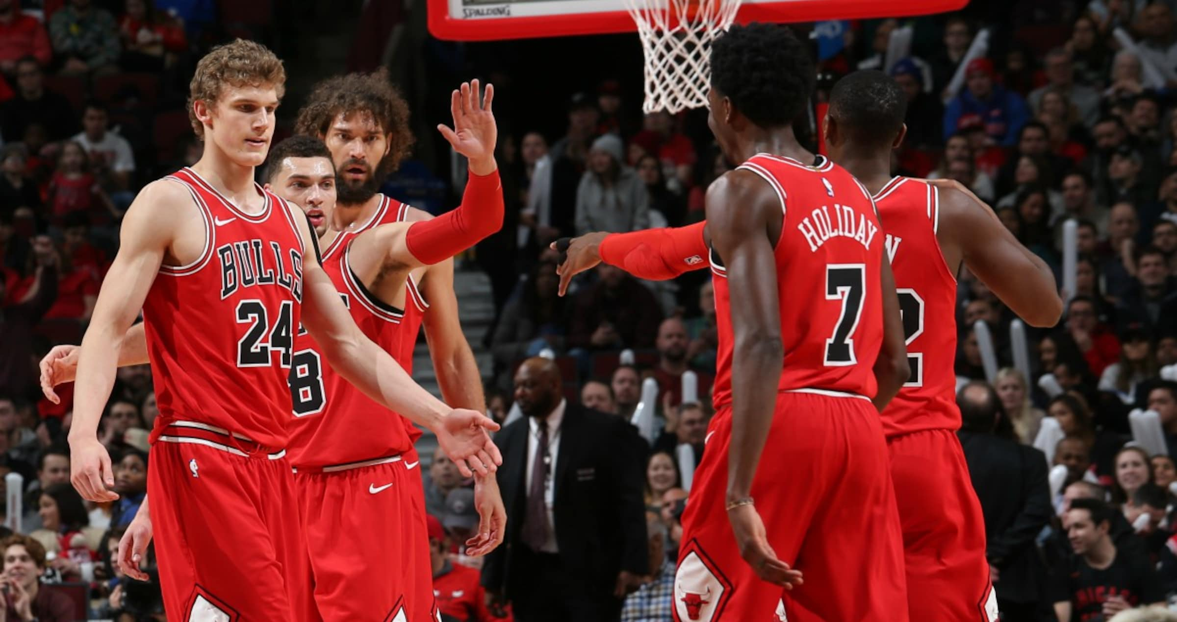 The Bulls high-five each other, as the Bulls take down the Pistons at the United Center 107-105.