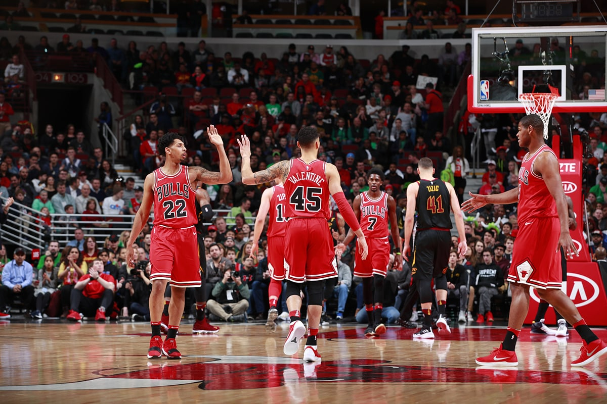 Denzel Valentine and Cam Payne of the Chicago Bulls share a high-five