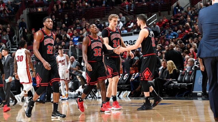 The Bulls players walk off the court against the Miami Heat
