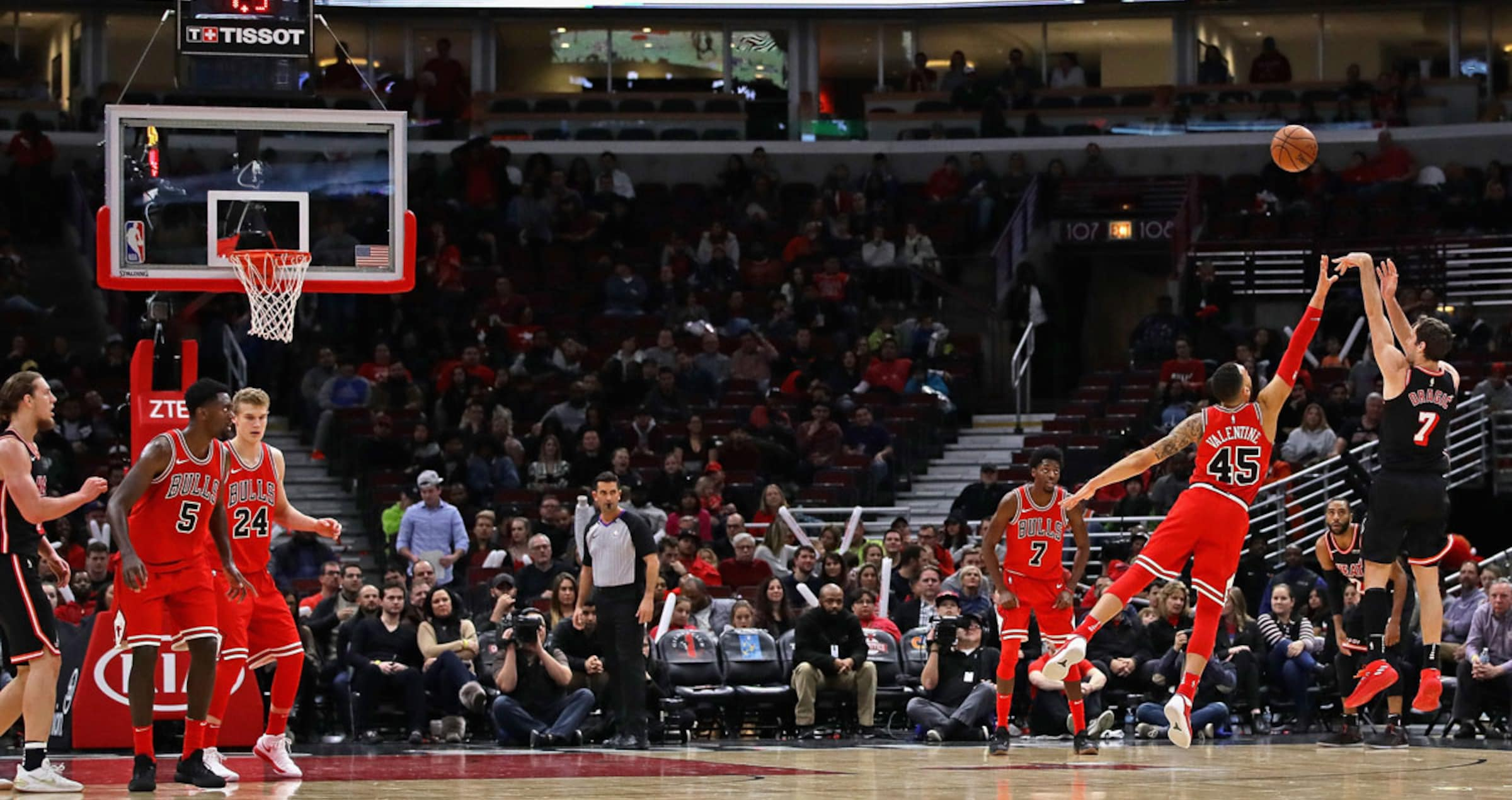 Goran Dragic #7 of the Miami Heat puts up a three point shot over Denzel Valentine #45 of the Chicago Bulls on hois way to a team-high 24 points at the United Center on November 26, 2017 in Chicago, Illinois.
