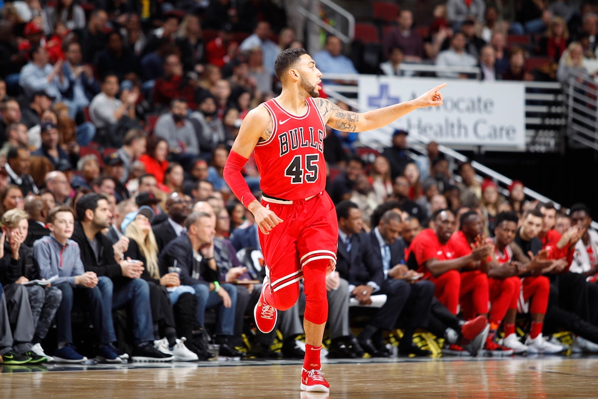 Denzel Valentine #45 of the Chicago Bulls raises his hand an points at a teammate after scoring during the game against the Charlotte Hornets on November 17 at the United Center in Chicago, Illinois.