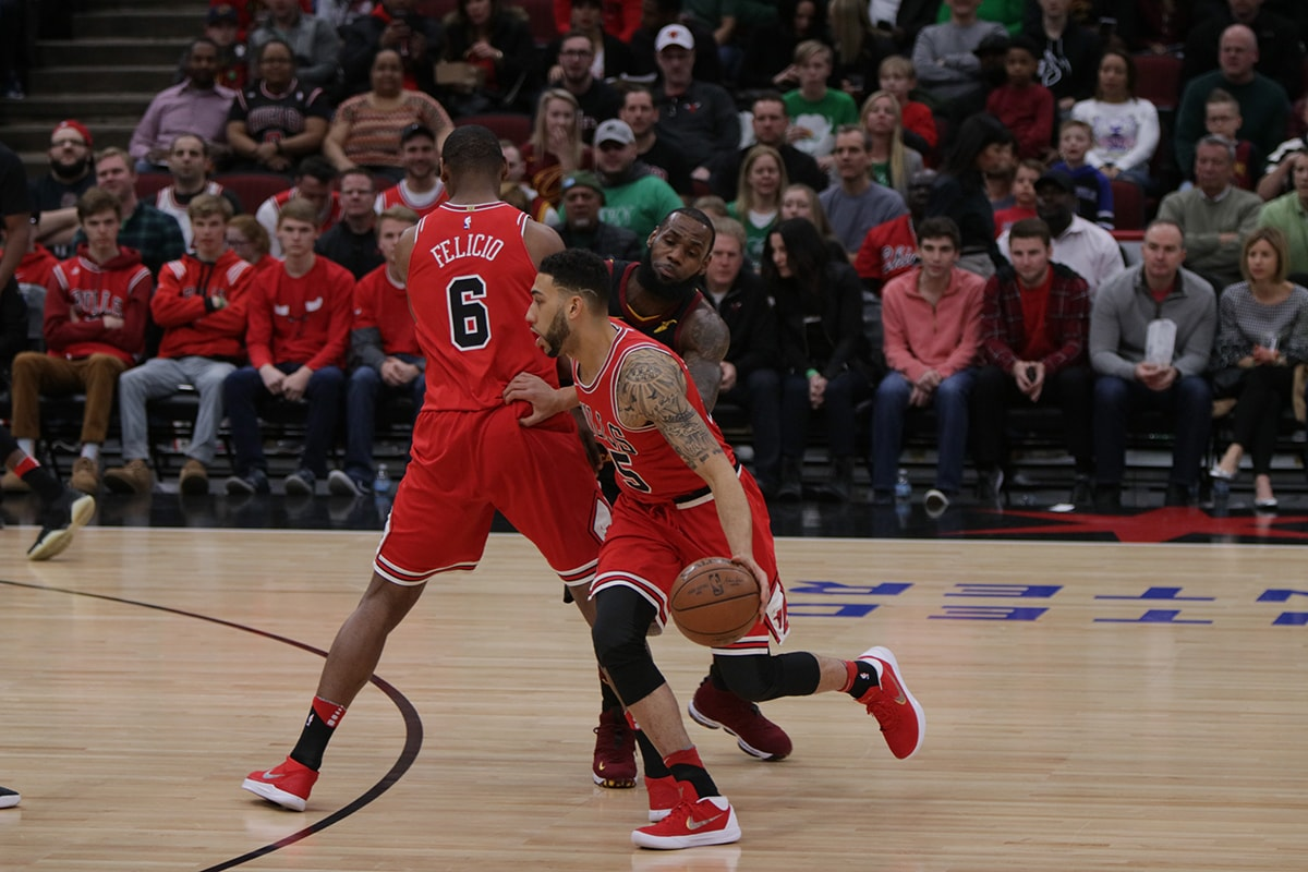 Felicio sets a screen on LeBron James as Denzel Valentine dribbles the ball