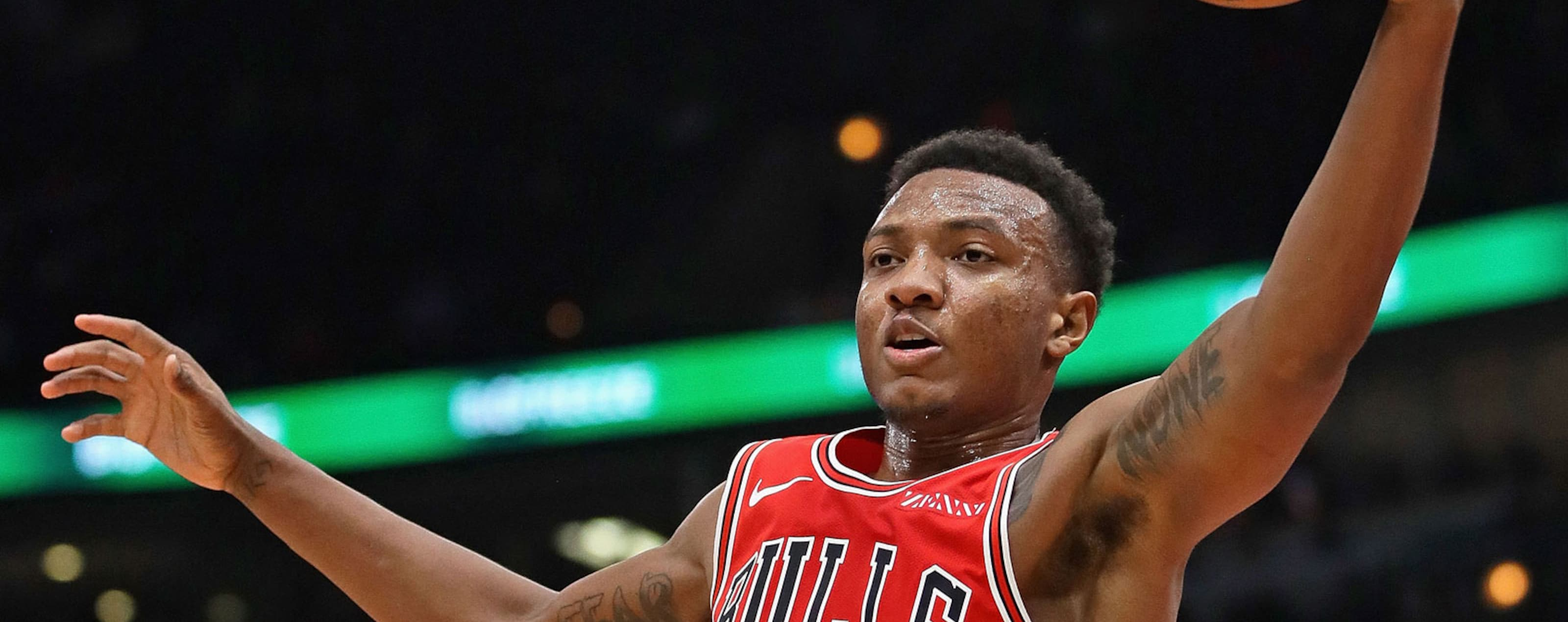 Wendell Carter Jr. #34 of the Chicago Bulls rebounds over Bogdan Bogdanovic #8 of the Sacramento Kings at the United Center on December 10, 2018 in Chicago, Illinois.