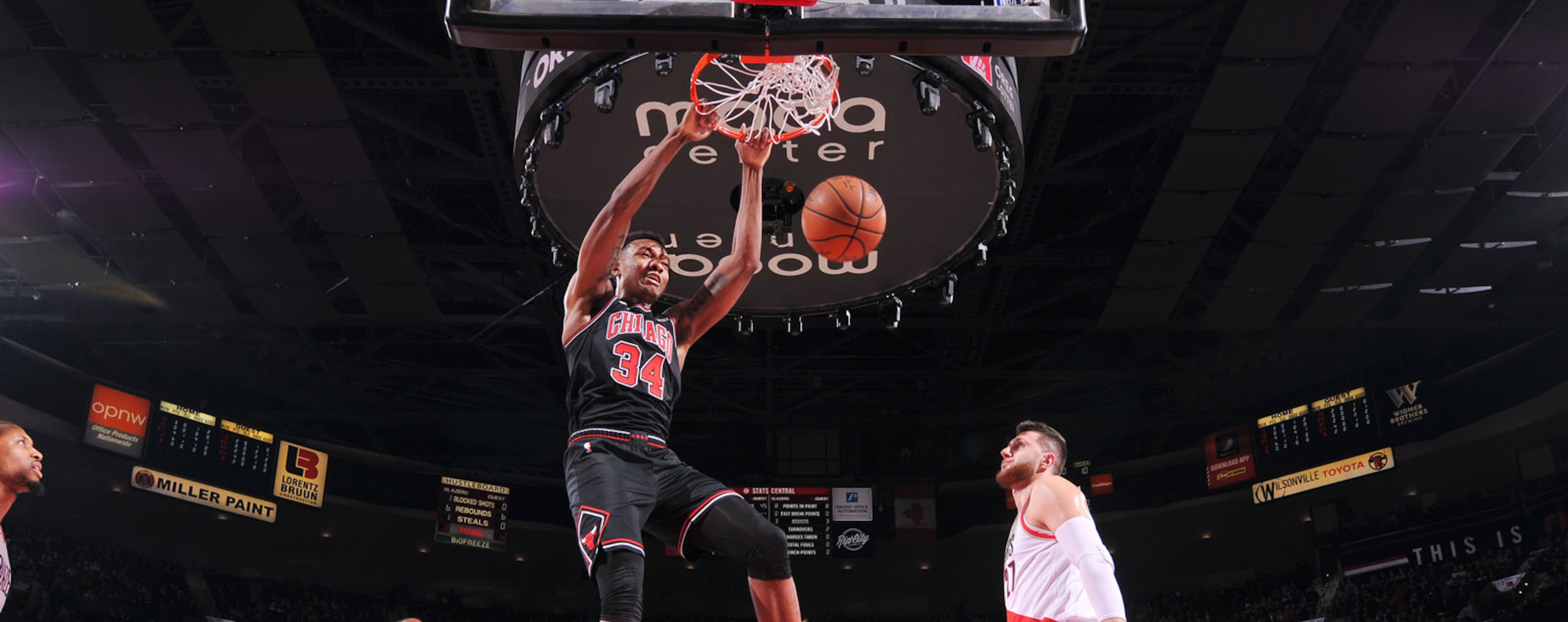 Wendell Carter Jr. #34 of the Chicago Bulls dunks the ball during the game against the Portland Trail Blazers on January 9, 2019 at the Moda Center Arena in Portland, Oregon.