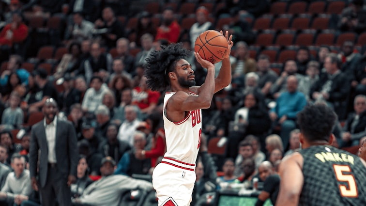 Coby White shoots against the Hawks