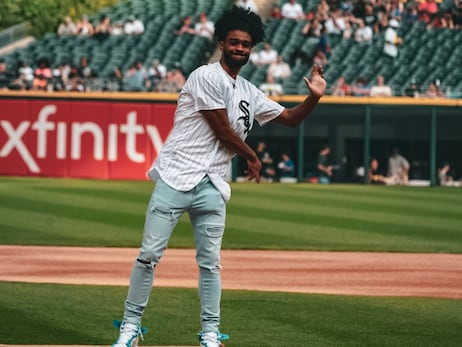 Coby White and Daniel Gafford Throw First Pitches